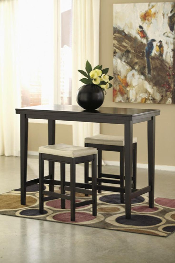 The Straight Line Contemporary Design Of Kimonte Dining Room Set By Signature Ashley Furniture Features A Dark Brown Finish Coating Sleek