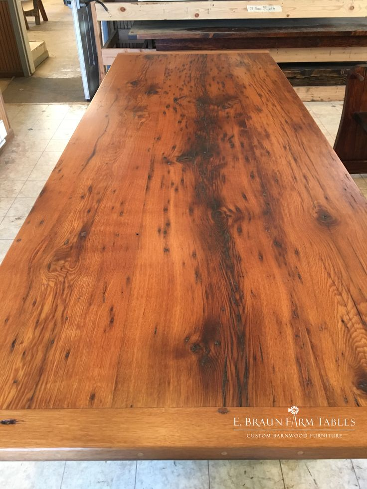 This close-up photo shows a medium character, natural color oak table top made from old reclaimed barn wood. Notice the beautiful golden glow of the wood? Tables like this can warm up any house. All furniture is custom made by E. Braun Farm Tables and Furniture, located in the heart of Amish country, Lancaster County, PA. www.braunfarmtables.com