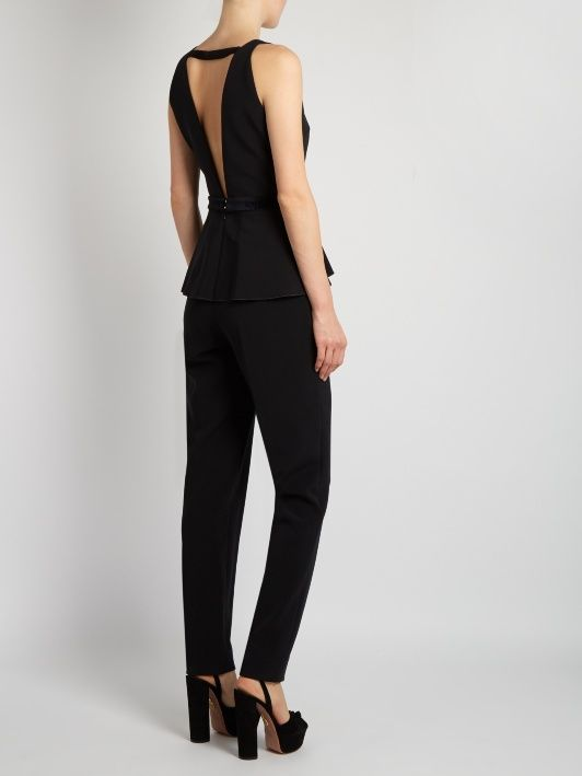 Roksanda is revered for her architectural, figure-flattering silhouettes, and this Nevarro jumpsuit is an especially sleek example. Exclusive to MATCHESFASHION.COM, it's designed with a plunging V-neck and back, waist-whittling peplum, and midnight-blue velvet tie for the most feminine definition. Add a colour-pop box bag and towering platform sandals for your next evening event.
