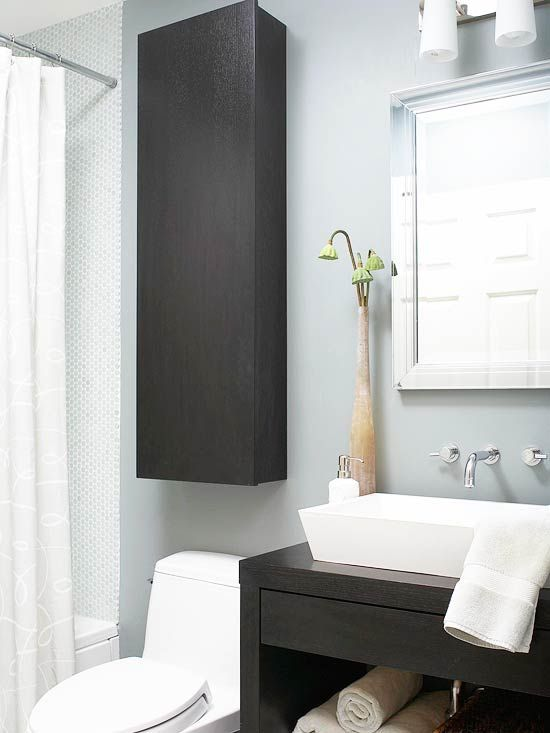 Employ the wall space above your toilet for storage. Hang a cabinet above the toilet and use it to store extra toilet paper, linens or toiletries. Pick up a single cabinet at an architectural salvage or building materials salvage store, such as Habitat for Humanity's ReStore. Paint or refinish the cabinet to match your decor, and mount it on the wall using hardware designed for that purpose