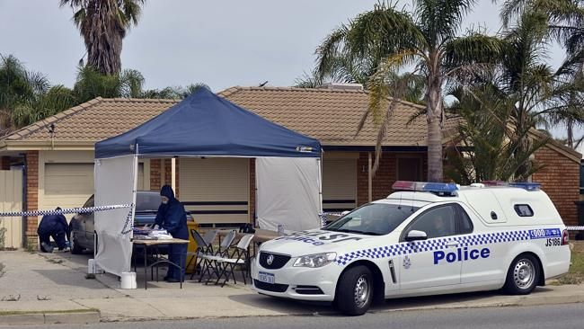 Forensic police search the house believed to be the home of a man found dead in Hilbert.