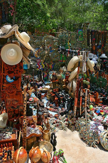 This is a Haitian market. It is filled with beautiful arts and crafts that are handmade.