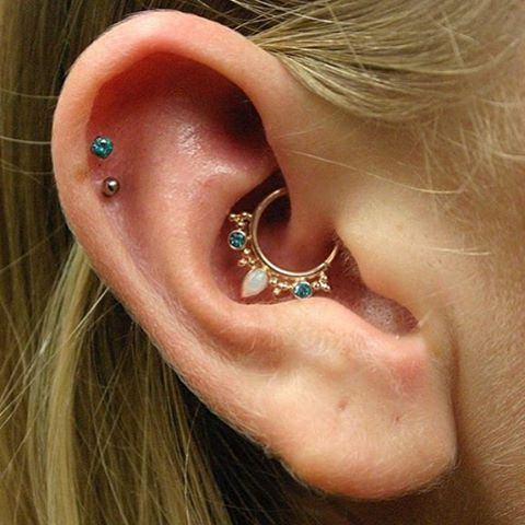 White Opals and Paraiba Topaz on Rose Gold from @bvla in this Daith piercing
