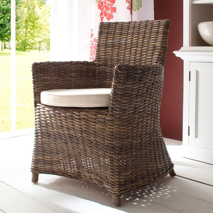 The Countess chair showcases strong yet swooping lines that bring a softness to the entire piece. Let's start with the arcs that swing down from its arms to the base. Then there's the intersecting bow at the front and back. But the part that's perhaps most defining is the wraparound piece of natural rattan that forms the arms and back support to create a welcoming and comfortable seat.