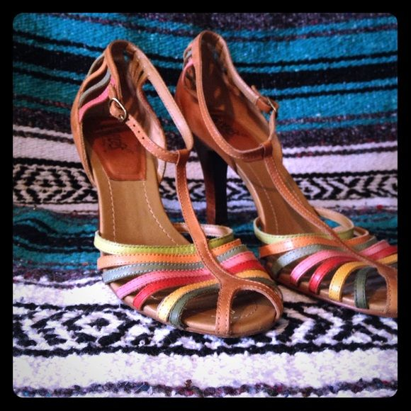 Carlos Santana multi-colored leather heel. Size 10 Carlos Santa brand multi colored strappy heel. Goes great with everything spring, summer and fall. Richly colored straps and rich leather make this shoe chic and rich looking. Gently used and in great condition. Carlos Santana Shoes Heels