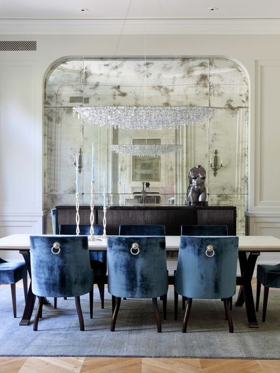 """Love the antiqued mirror wall and the chairs and chandelier. So unique."""""""