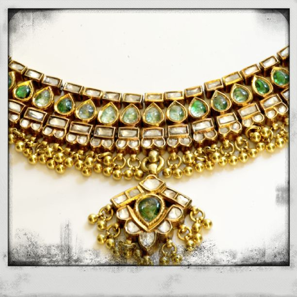 This antique necklace belonged to my great grandmom, and was commissioned in the 1930s. Designed and handmade in Bikaner. Made with pure gold, uncut diamonds and emerald stones. Emotionally invaluable. This particular set consists of necklace, earrings and a bracelet. It has been intact ever since, without any loss of shine or any sort of wear-off. I have named it : the swordlily necklace.