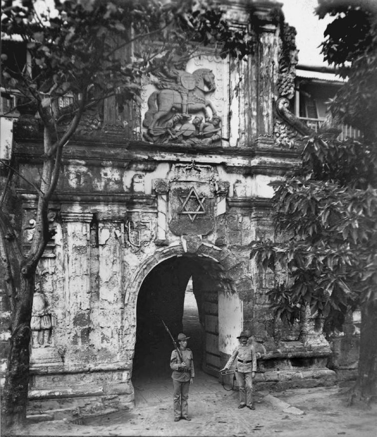 Fort Santiago main gate with six pointed star above doorway, late 19th or early 20th century. Intramuros, Manila, Philippines | This is a controversial photograph with the six-pointed star above the doorway.  What the meaning was and why it was there is a mystery.  It could be the Jewish Star of David or it could be symbolic having other meanings.  If anyone knows what it could mean in this situation please let us know. Notice that the gate is in a deteriorated con...