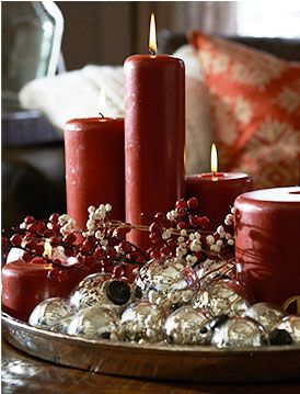 Create a holiday coffee table moment with a tray filled with ornaments and candles.