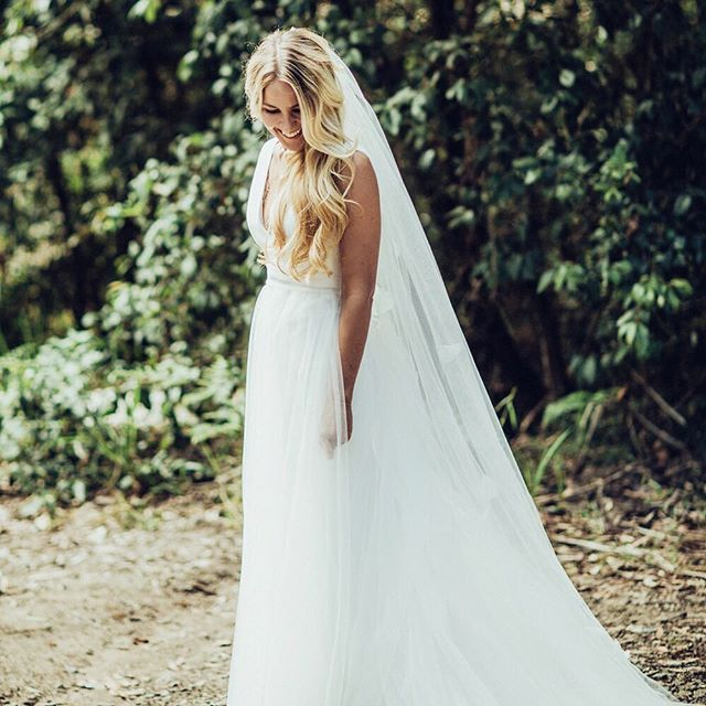 Beautiful Sydney bride Liv - dress designed by Moira Hughes Couture. V neck, sleek gown, garden wedding