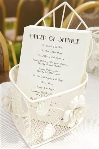 Pretty vintage-themed cream wire baskets to hold the Order of Service.