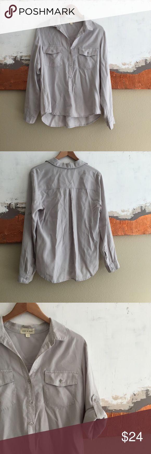 Anthro Cloth & Stone gray button down shirt Anthropologie brand Cloth & Stone light gray button down shirt. Long sleeved shirt with collar and buttons halfway down front of shirt. Two buttoned breast pockets. Roll tab sleeves can be worn long or cuffed. High-low hem, casual oversized fit. Size Large, in very good used condition. 100% tencel. Anthropologie Tops Button Down Shirts