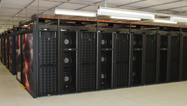 The Raijin supercomputer - rows of black computer processors in a large room.