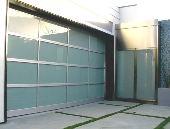 Modern glass garage door and entry door. Frosted glass for privacy.