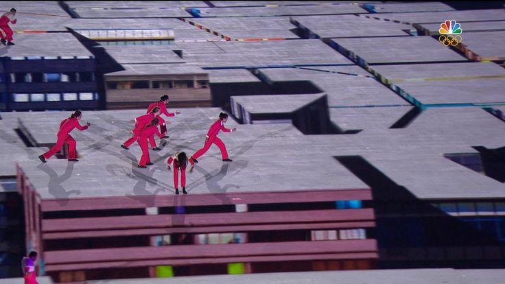 Performers wow crowd with acrobatic floor projection routine