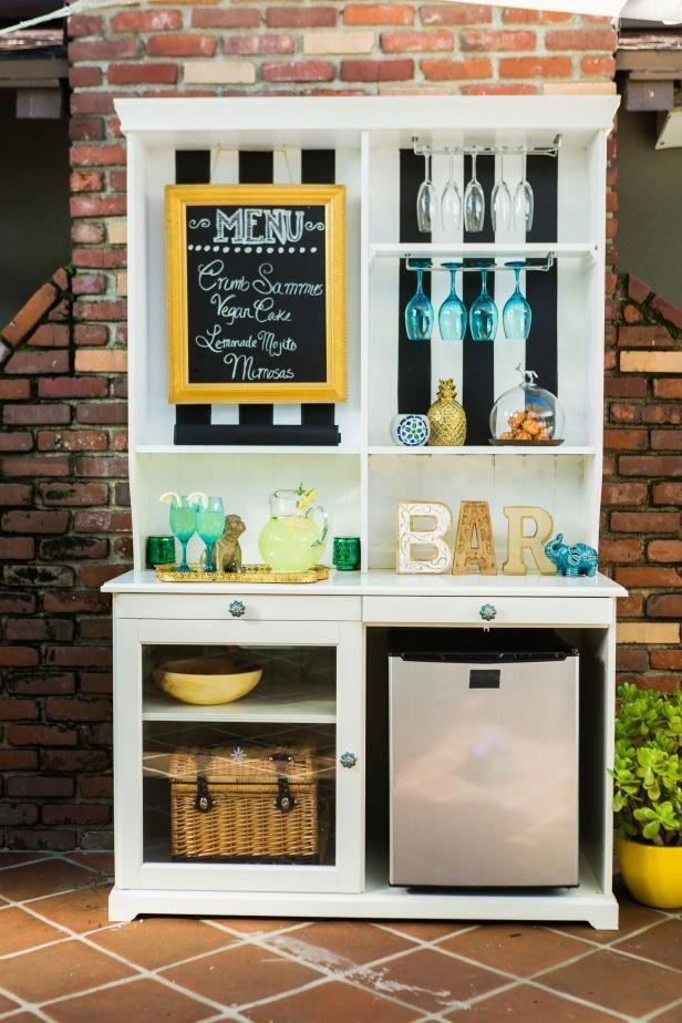 Have an old hutch or cabinet at home that's just collecting dust? Turn it into a beverage and food station for your outdoor entertaining area. Add a mini fridge and wine glass racks, and you'll have yourself a multifunctional piece of furniture for serving and storage in no time.