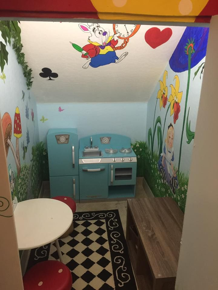 This under the stairs play space is every child's dream come true!