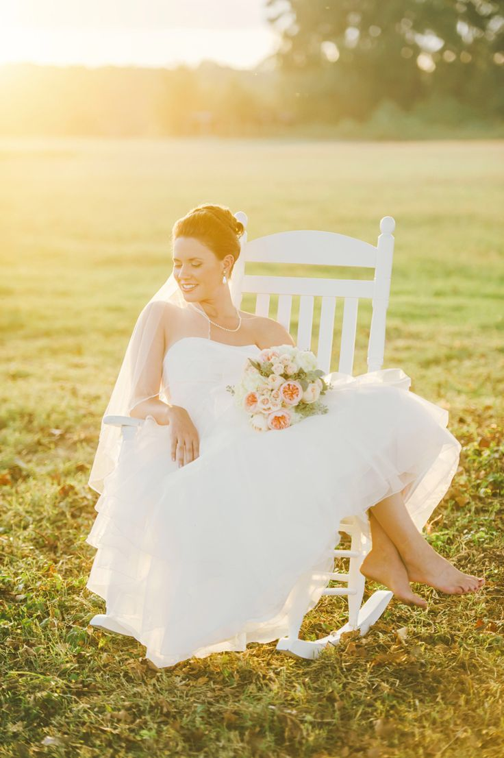 Wedding dress bridal portrait outdoors in rocking chair. Connection Photo.