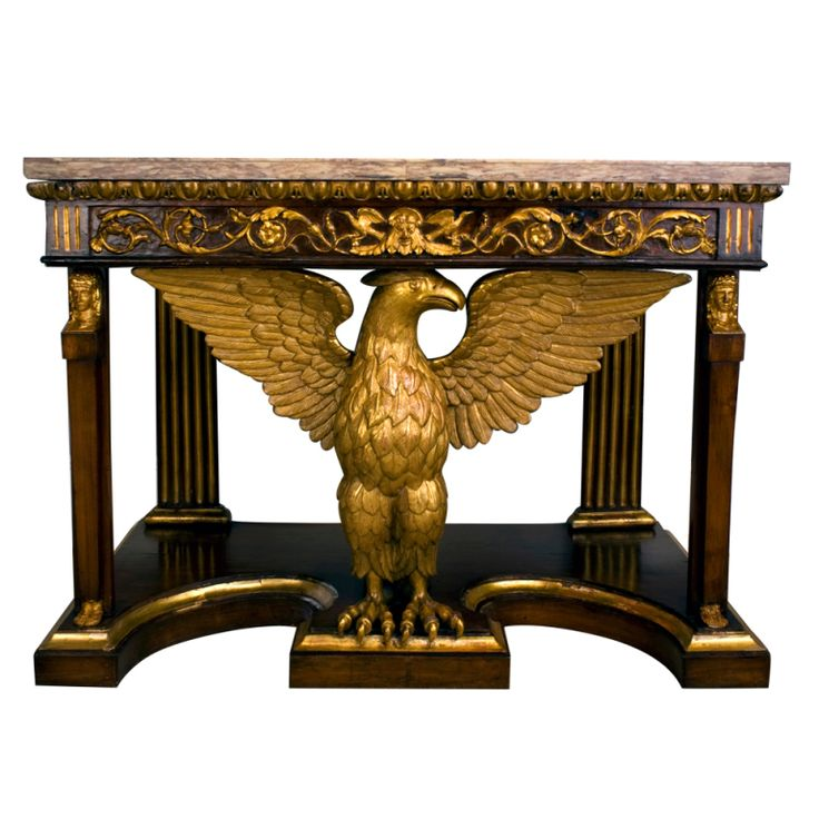 Tuscan neoclassical pier table with eagle motif, ca.1820. Rectangular onyx top sits above ornately carved frieze. Fluted rear columns and tapered front columns with carved and gilt heads and feet provide support. Centered is an elaborately carved gilt wood figure of an eagle with wings spread