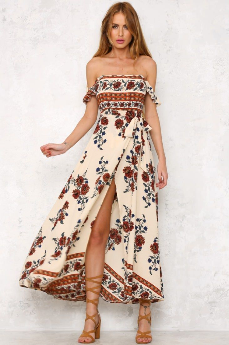 The Sienna Maxi Dress has an off the shoulder neckline, with a partially boned bust and a tie up front detail. There is an exposed back zip and cross over, tulip shaped hemline. Style yours with gladiator sandals.  Dress. Not lined. Cold hand wash only. Model is standard XS and is wearing XS. True to size Print placement may vary. Non stretchy fabric. Polyester.