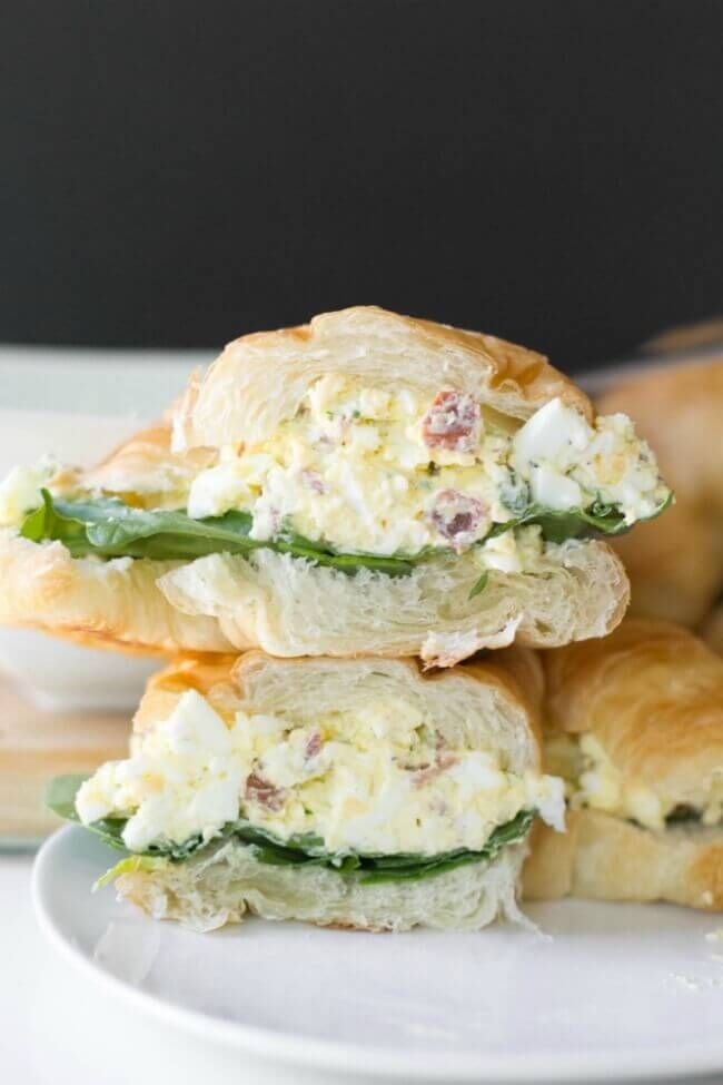 Best Egg Salad Sandwich Ever. Eggs, bacon, chives, Cheddar, cream cheese, and mayo served on a croissant with fresh spinach. ♥ Spaceships and Laser Beams