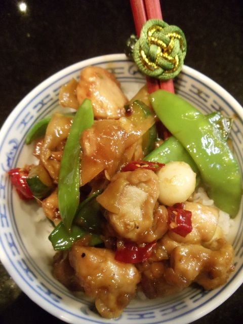 Chicken thighs stir fried with red chilli and garlic chives.  Chef Kylie Kwong.