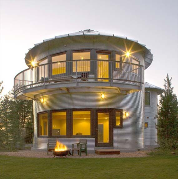 It's like a big metal cylinder drum given some holes and used for shelter. Let's call it metal house with circular architecture and this seems take the contemporary rural design
