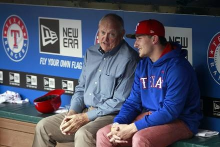 Texas A & M quarterback and 2013 Heisman trophy winner Johnny Manziel talks with Texas Rangers CEO Nolan Ryan before throwing the first pitch before a MLB baseball game between the Texas Rangers and the Los Angeles Angels at Rangers Ballpark in Arlington on April 7, 2013.