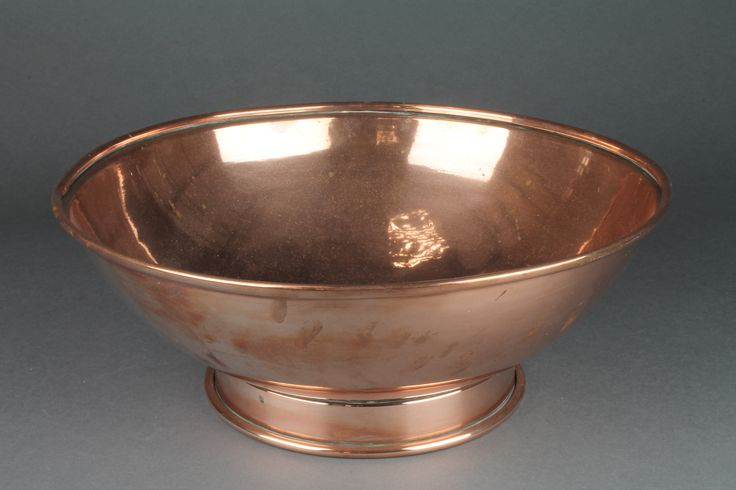 """Lot 306 A circular copper bowl raised on a spreading foot 14"""" diam. sold for £75"""