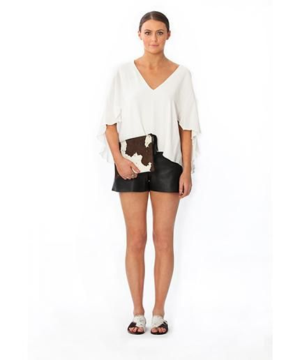 Cowhide fur tassel clutch and slides.