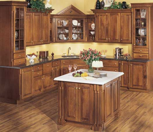 starmark cabinetry hanover door style in cherry finished in nutmeg with chocolate glaze. Black Bedroom Furniture Sets. Home Design Ideas