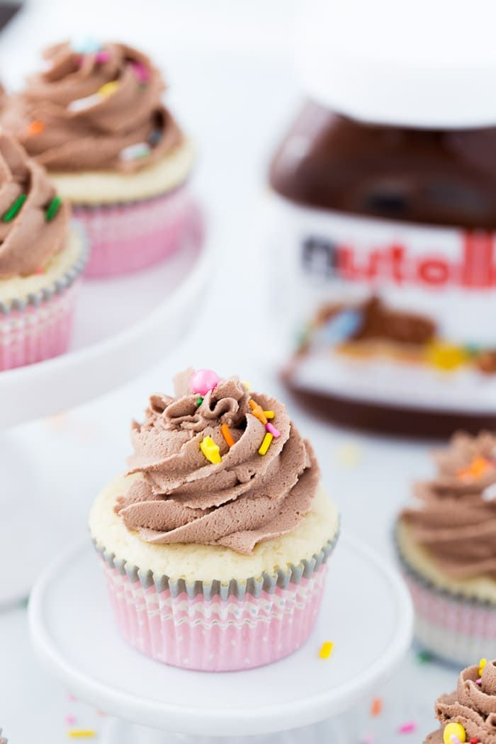 A rich vanilla bean cupcake topped with whipped Nutella buttercream is a classic recipe everyone should have in their recipe box! #cupcakes #nutella