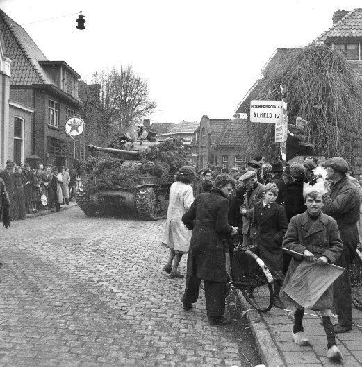 Tanks of the 4th Canadian Armoured Division enter Delden, Netherlands on Apr. 4, 1945.