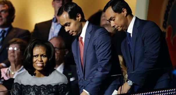 First lady Michelle Obama sits with Julian Castro (right) and his brother Joaquin Castro (center) at the Democratic National Convention in C...