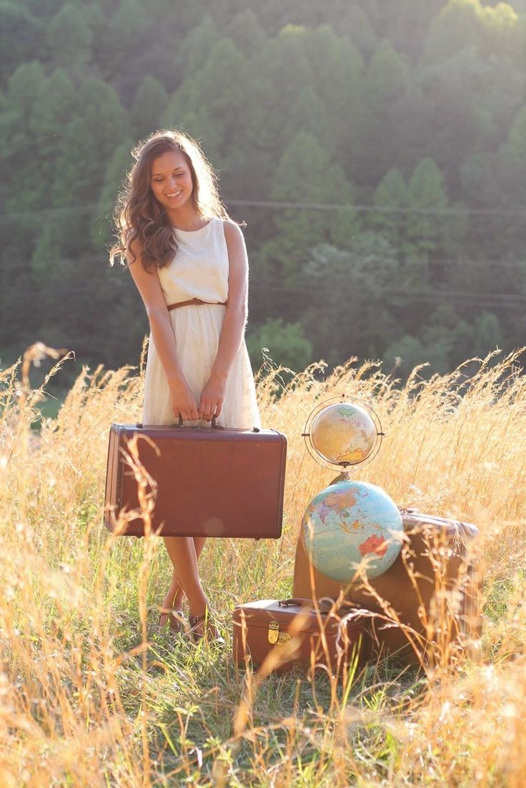 Travel inspired senior shoot-suitcases-the world- by Talara jo photography