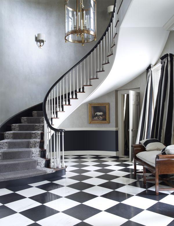 Interior design by Nancy Braithwaite Love the black, white and gray scheme --don't miss the drapery and stair runner. #NancyBraithwaite #entry