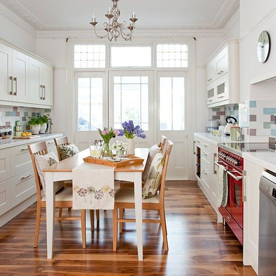 White country kitchen with multicoloured tiles and Shaker-style units