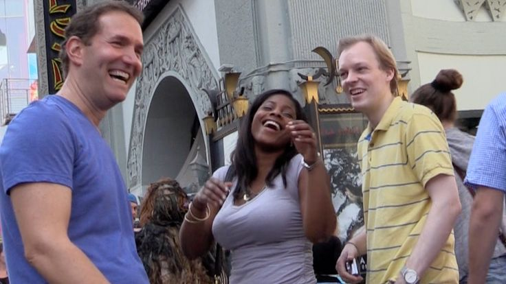 Greg Benson Confuses Hollywood Tourists by Photobombing the Photos That He Takes of Them
