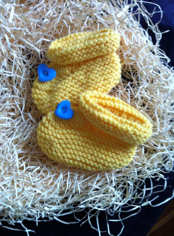 Yellow booties with blue hearts. size 0.