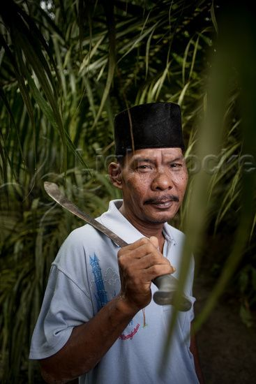 The village of Dosan in Sumatra's Riau province is showing Indonesia the way in producing eco-friendly palm oil. This is one of the villagers, small land owner Rahman, who produces palm oil on what was depleted forest land, while working to protect primary rainforest around the area. Photo Jonas Gratzer 2013.
