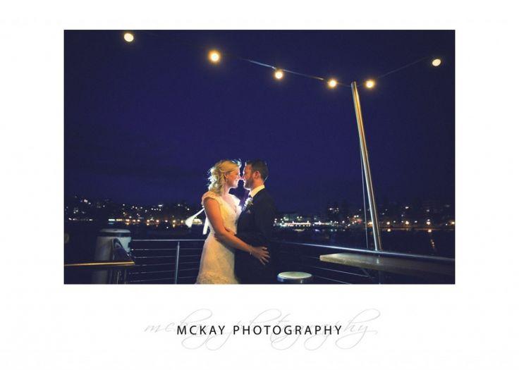 Krystle & Adam - night photo under lights at Manly Skiff Club  #mckayphotography #nightshot #manlyskiffclub #wedding