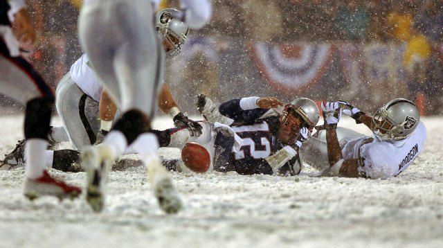 "The 2001 AFC divisional playoff game, also known as the ""Tuck Rule Game, Charles Woodson did not enjoy the aftermath of this play. (Getty Images)"