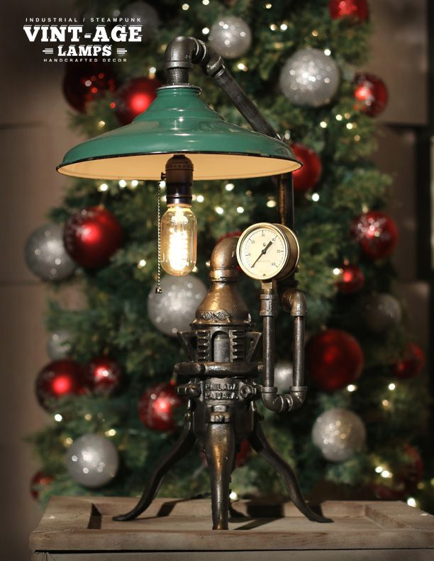 This hand crafted Lamp features an antique Victorian cast iron Christmas tree stand manufactured by North Bros Philadelphia USA from 1900 to 1947 this company is now called Stanley Tools! Still manufacturing tools and safety equipment to suppliers globally to this date.  This lamp also features a vintage baked enamel industrial shade and 1950 's brass regulator gauge with beveled glass