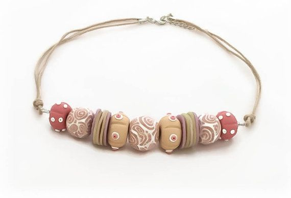 Seashell Statement Necklaces for Women by Lottieoflondon Taking inspiration from nature and the ocean this beautiful seashell necklace has been hand crafted from polymer clay and decorated with seashell print beads #lottieoflondon
