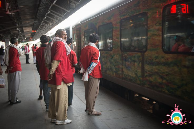 Coolies {porters} on the platform at the Dehli railway station wait for passengers to come off of the Amritsar - Delhi Shatabdi express.