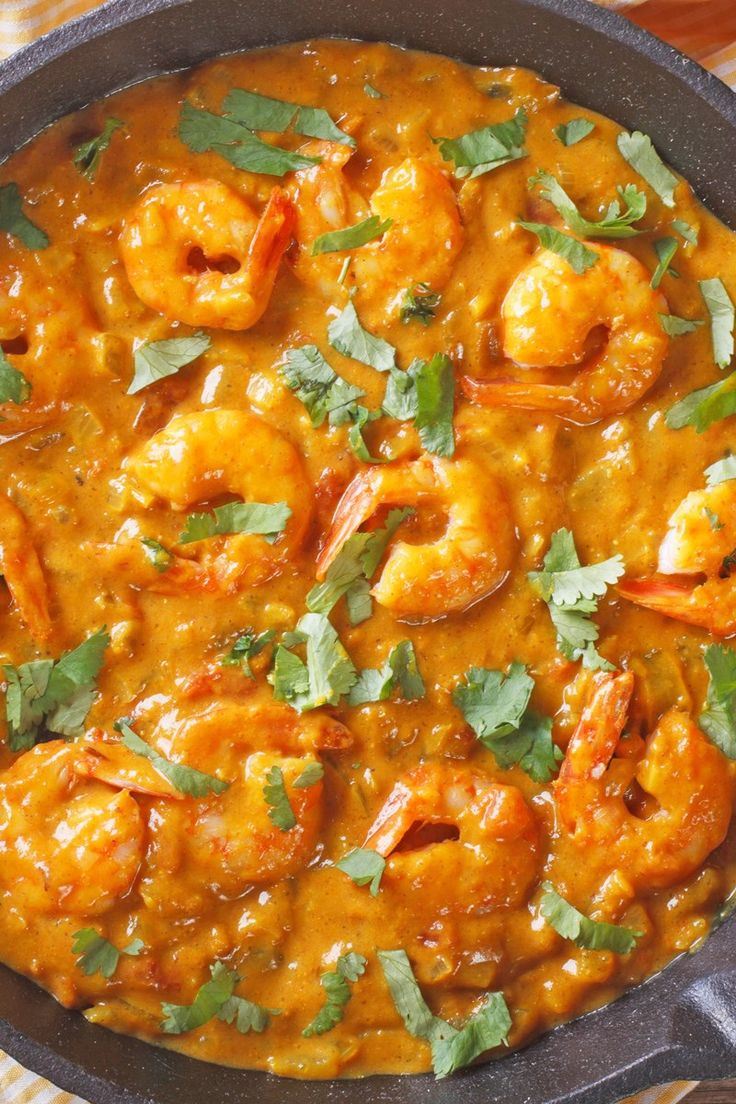 Recipe including course(s): Entrée; and ingredients: cayenne pepper, cinnamon, coconut milk, coriander, cumin, fresh cilantro, fresh ginger, garlic, lime, oil, onion, salt, shrimp , tomatoes, turmeric, water