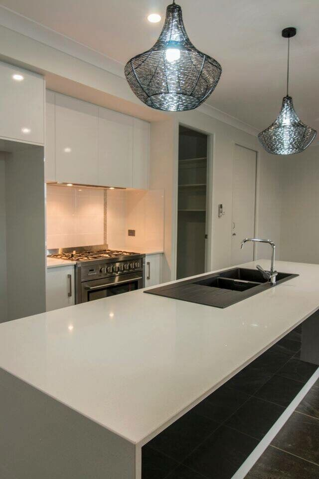 Gloss kitchen with Stone Benchtops and Stone Sink