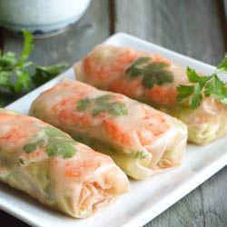 Delicious Vietnamese summer rolls with shrimp, cilantro, basil, and daikon radish