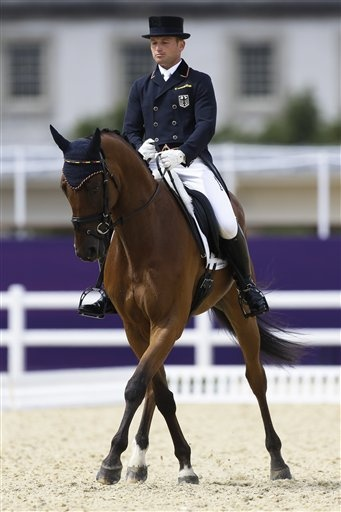 London Olympics Equestrian  July 29Michael Jung of Germany competes with his horse Sam in the equestrian eventing dressage phase during the equestrian eventing competition at Greenwich Park, at the 2012 Summer Olympics, Sunday, July 29, 2012, in London. (AP Photo/Markus Schreiber)
