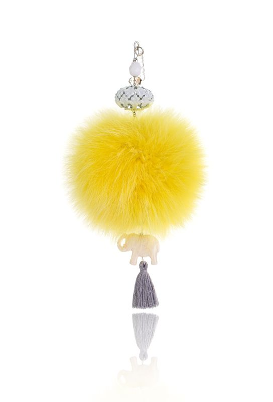 Pompon mobile Charm with 7cm yellow real fox fur, mobile clip, crystal beads and decorative elements.  Price: 21.00E